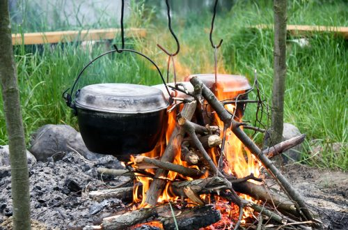 Cooking a meal on a campfire in metal vesselsCooking a meal on a campfire in metal vessels